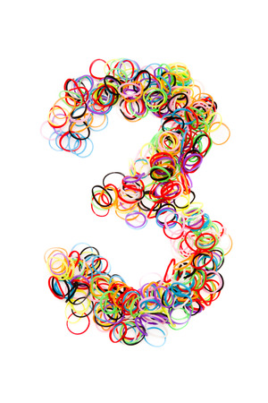 Colorful elastic rubber bands shape Number three ,isolated on a white background