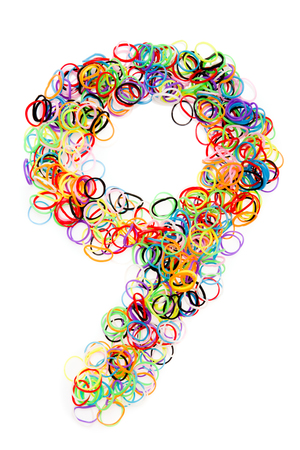 Colorful elastic rubber bands shape Number nine isolated on a white background