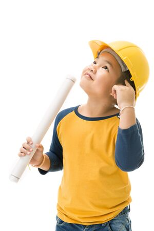 Young asian child construction Worker Holding equipment and think about, isolated on white background photo