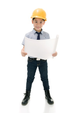 drawing boy: Young asian child construction engineer Holding equipment isolated on white background