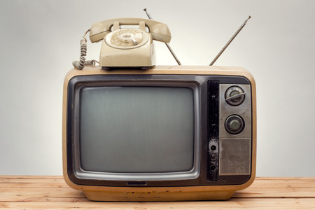 old television: old phone and old tv vintage style on gray background .