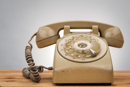 passe: vintage telephone on wood background