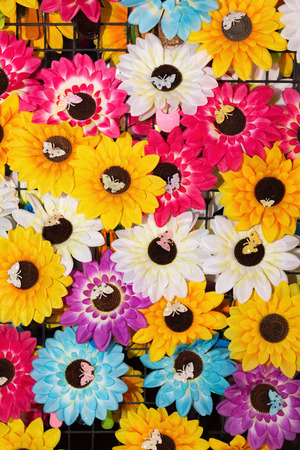 Colorful plastic sun flower as background photo