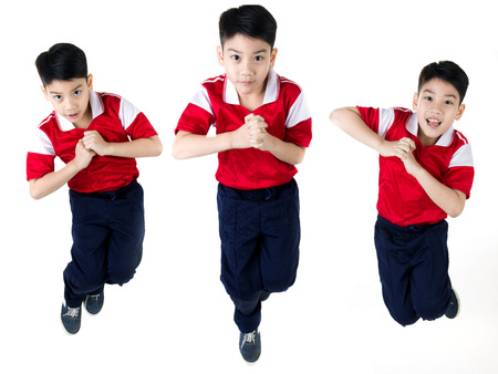 Group of Asian boy  jumping over white background photo