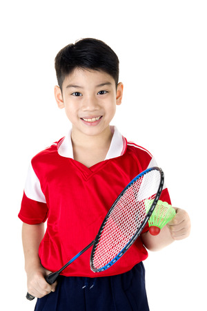 Happy Asian boy in badminton action isolate on white background