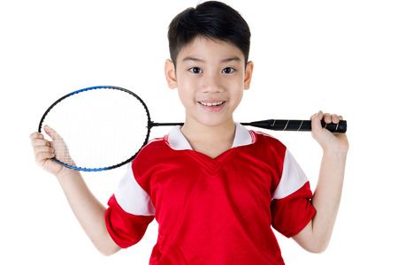 Happy Asian boy in badminton action isolate on white background photo