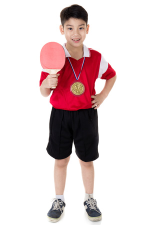 Portrait of Happy asian boy play table tennis isolated on white background photo