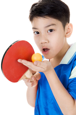 Portrait of Happy asian boy play table tennis isolated on white background Stock Photo