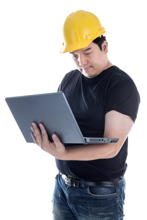 Asian Engineer checking on production on laptop on white background