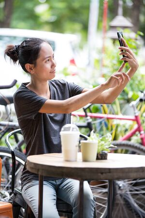 happy moment: Happy asian woman  selfy - Best female friends catching the moment with modern smartphone