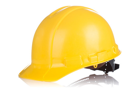Yellow Safety helmet with shadows isolated on white background Foto de archivo
