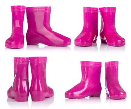 wellie: Group of Pink rubber boots for kids isolated on white background
