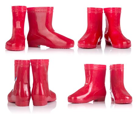galoshes: Group of Red rubber boots for kids isolated on white background