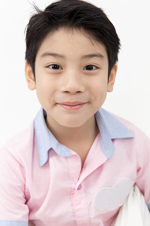 kid smile: Portrait of Happy asian boy with smile face on gray background