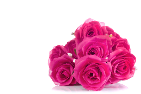 beautiful nature: bouquet of plastic pink roses isolated on white background