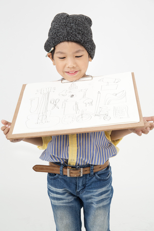 asian art: Happy Asian little artist boy showing art board on gray background Stock Photo