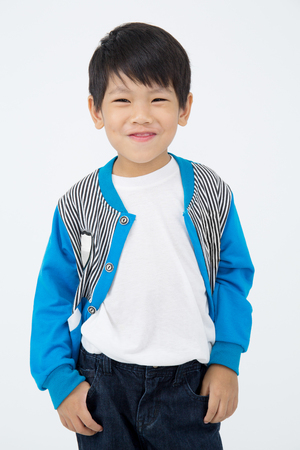 Portrait of Asian cute boy over on gray background ,Happy face Stock Photo