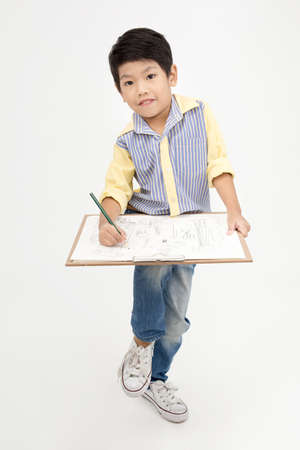 asian art: Happy Asian little artist boy holding art board on gray background