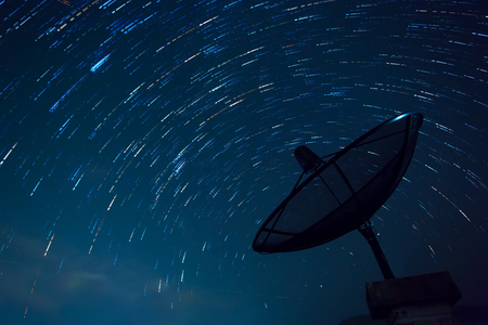 Satellite Dish and Star Trails. Blue sky. Stok Fotoğraf - 54353086