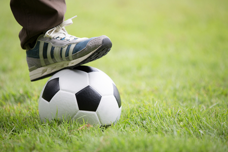 socker: Close up of feet on top of soccer ball Stock Photo