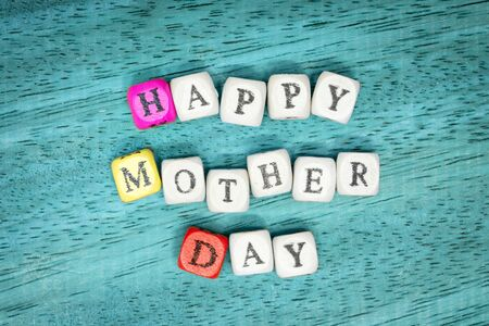 Happy mothers day on wood background
