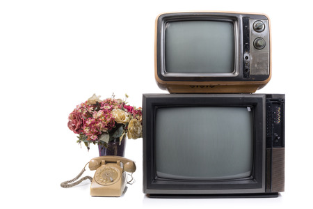 electronic 80s: Vintage Television and telephone with flower on white background