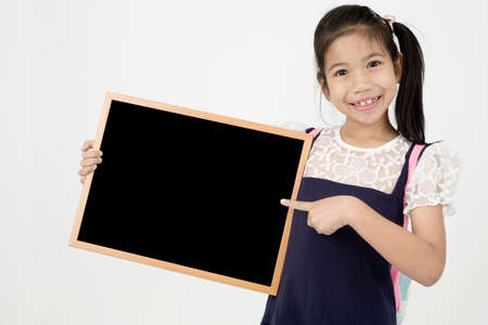 preteens girl: Happy Asian preteens girl hand holding wood board  on gray background with smile face