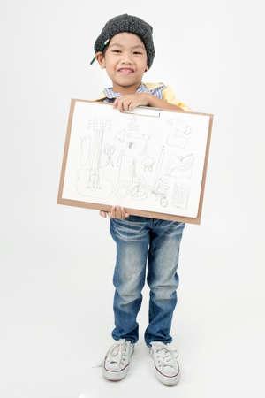 asian art: Happy Asian little artist boy holding art board  on gray background