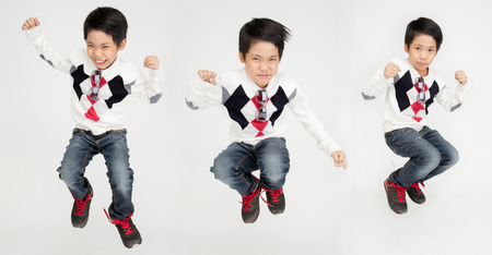 Group of Asian cute boy is jumping with smile face ,Isolated on white background
