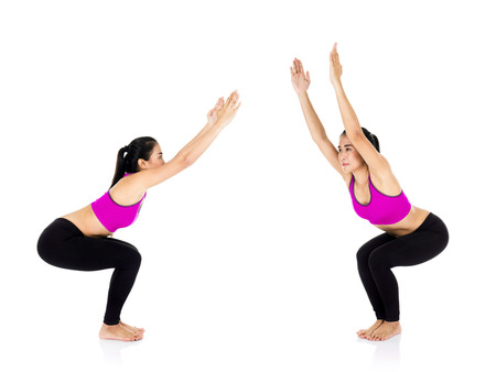 active wear: Group of Yoga woman - pretty asian female in active wear doing yoga on white background Stock Photo