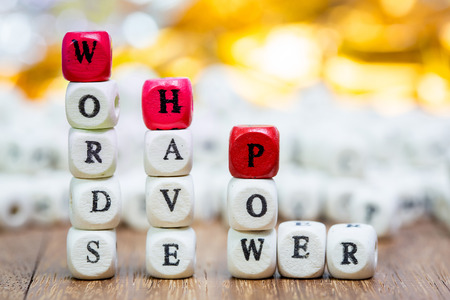 Stack of Words have power dice puzzle on wood background , Inspiration concept .