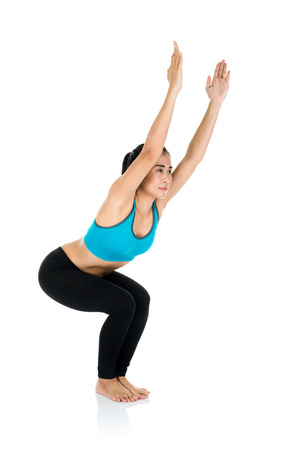 active wear: Yoga woman - pretty asian female in active wear doing yoga on white background Stock Photo