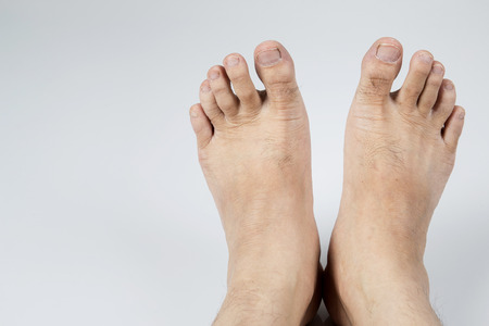 Male feet on gray background . With copy space Stock Photo