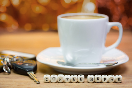 Cup of coffee with keys, Coffee break concept,  focus text on dice