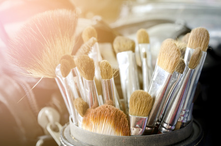 Old make-up brushes in holder in the morning Stock Photo