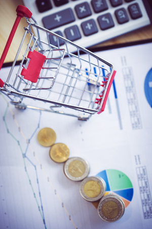 Shopping cart with coin . Ideas about online shopping, online shopping is a form of electronic commerce that allows consumers to directly buy goods from a seller over internet. Фото со стока