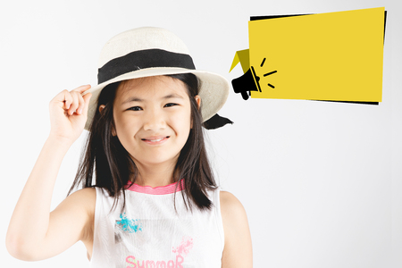 Asian girl child on gray background,  People sincere emotions lifestyle concept. Mock up copy space, Girl acting on face with dialog box for add you text.