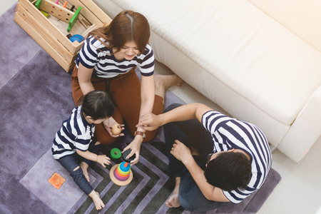 Happy asian family father and mother enjoying with child, Family lifestyle at home 版權商用圖片