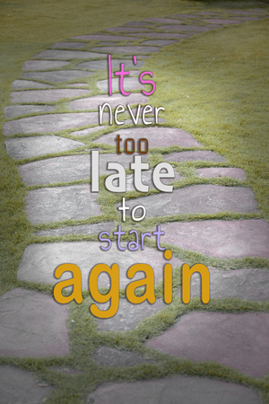 "The Stone block walk path in the park with word ""It's never too late to start again"""