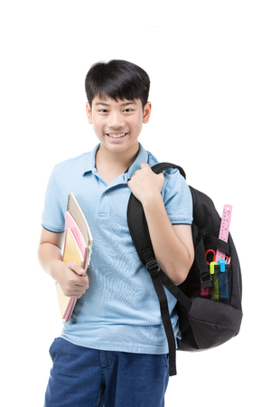Portrait of smiling little student boy in blue polo t-shirt in with books and bag over white background - school, education and people concept