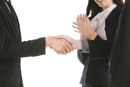 Business people shaking hands, finishing up a meeting isolate on white background. Banco de Imagens