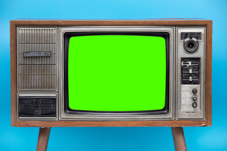 Vintage TV : old retro TV set isolated on blue background.  Bank Green sceen with copy space .