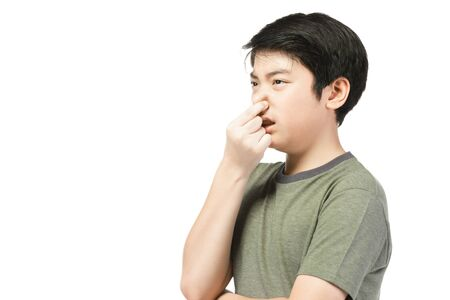 Close up of pretty little boy with black hair in funny acting trying to amusing. isolate on white background.