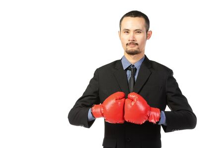 Business asian man ready to fight with boxing gloves , isolated over white background  Stok Fotoğraf
