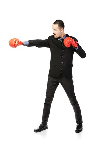 Business asian man ready to fight with boxing gloves , isolated over white background