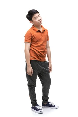 Young Asian Angry boy isolated on white background. Handsome smart serious ponder child. Stockfoto