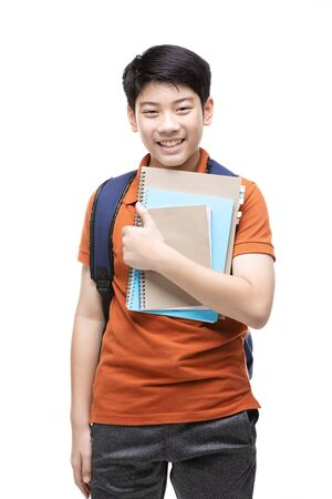 Cute asian child with school stationery on white background . Back to school concept. Banque d'images - 132044810