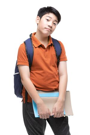 Cute asian child with school stationery on white background . Back to school concept. Banque d'images - 132044824