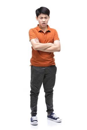 Young Asian Angry boy isolated on white background. Handsome smart serious ponder child. Stockfoto - 132044839