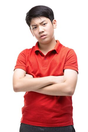 Young Asian Angry boy isolated on white background. Handsome smart serious ponder child. Stockfoto - 132044844